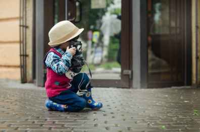 boy taking a photo using camera